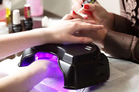 nails care of european girl in modern beauty salon Stock Photo