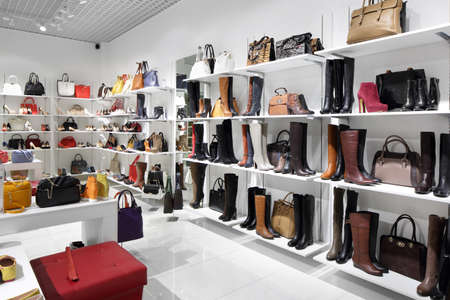 bright and fashionable interior of shoe store in modern mall 写真素材 - 97240669