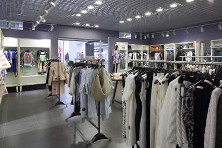 luxury and fashionable brand new interior of cloth store 写真素材 - 97241342