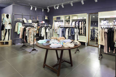 luxury and fashionable brand new interior of cloth store 写真素材 - 97241345