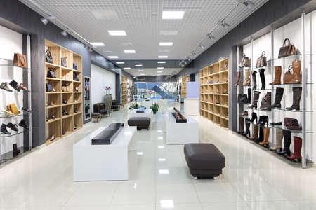 bright and fashionable interior of shoe store in modern mall Archivio Fotografico