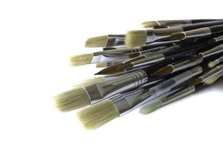 Assorted paintbrushes isolated on a white background. photo