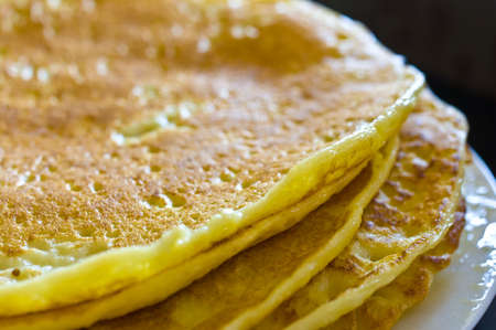 Detail of a pile of pancakes with short depth of field. photo