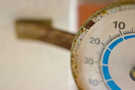 celcius: Old rusty thermometer outdoors