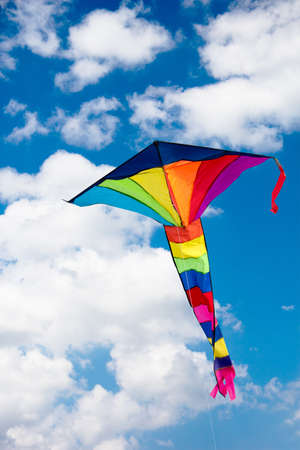 The colorful kite on the blue sky with clouds Stok Fotoğraf