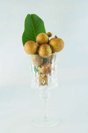 fruit or literally translated as Cat Eye Fruit , a subspecies of the Longan Fruit over white background. Banco de Imagens - 80399600