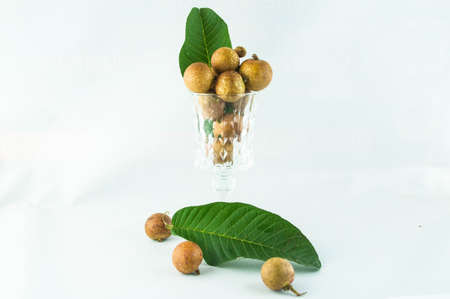 fruit or literally translated as Cat Eye Fruit , a subspecies of the Longan Fruit over white background.