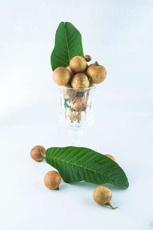 literally: fruit or literally translated as Cat Eye Fruit , a subspecies of the Longan Fruit over white background.