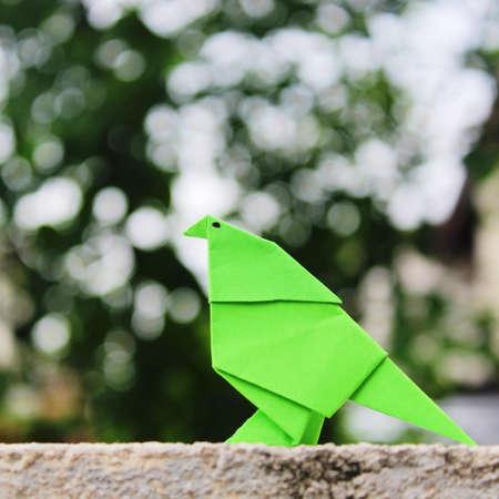 green origami bird
