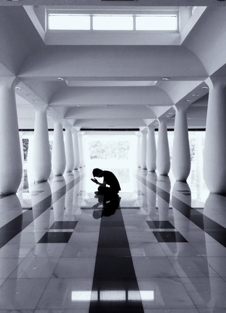 A man praying in a mosque