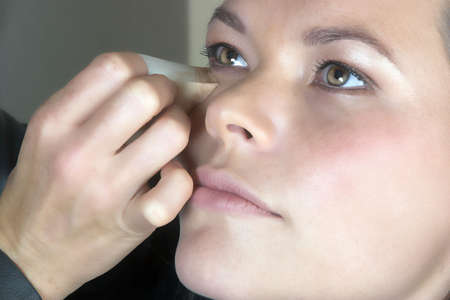 scincare:  Make-up artist applying foundation to young woman�s face