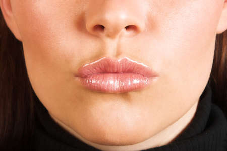 cropped: Cropped close-up of a young woman�s face, blowing a kiss