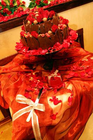 brown chocolate rose decorated wedding cake photo