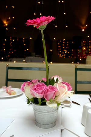 wedding table setting with pink and white roses and pink daisies Stock Photo - 430341