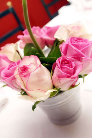 cor: pink and white rose arrangement in a tin bucket