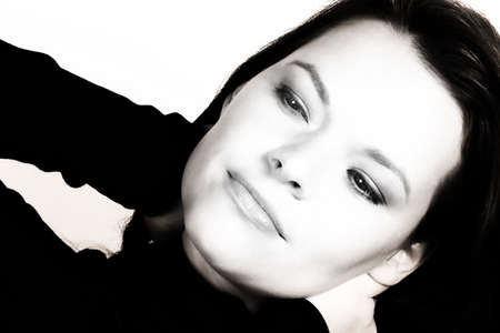 womanhood: Dreamy young woman in polo-neck stretching - black and white finish