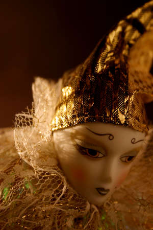 Shy doll with gold hat and room for copy photo