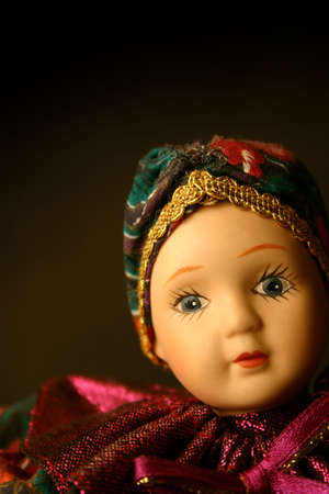 Little girl doll in pink dress photo