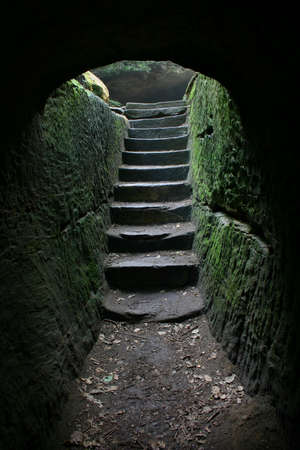 Stairs at the end of a cave...more in my portfolio. Stock Photo