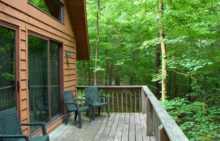 Cabin and wooden deck in the woods Stok Fotoğraf