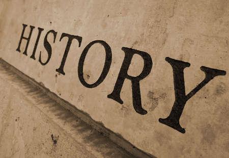 Het woord geschiedenis in steen gehouwen Stockfoto