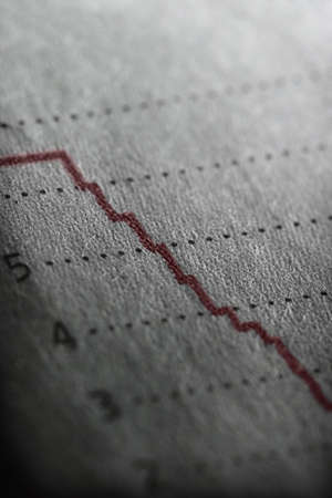 Shallow depth of field on a line graph going way down. Stok Fotoğraf