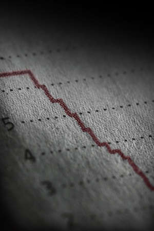 Shallow depth of field on a line graph going way down. Stock Photo