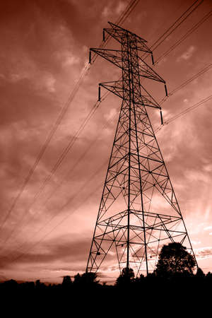 electric current: Silhouettes of power lines and a tower