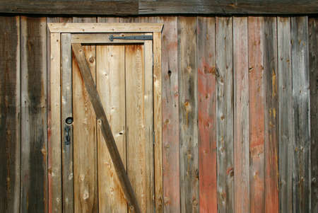 A wooden barn with interesting colors and textures.