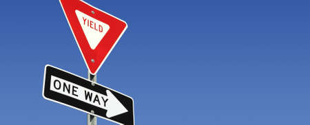 Yield and One Way road signs with room for copy