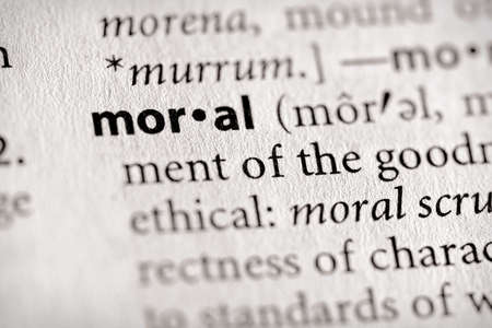 Selective focus on the word moral Stock Photo
