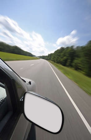Vehicle with blank rear view mirror for your text or graphics photo