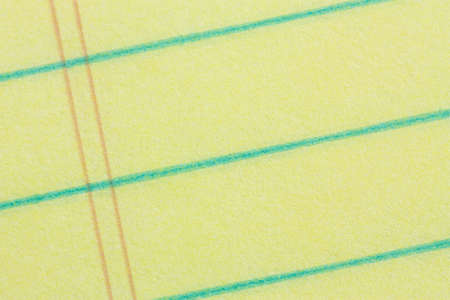 Close-up of legal pad of yellow paper background - add your business message Stock Photo - 4105051