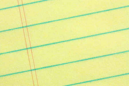 legal pad: Legal pad of yellow paper background - add your business message