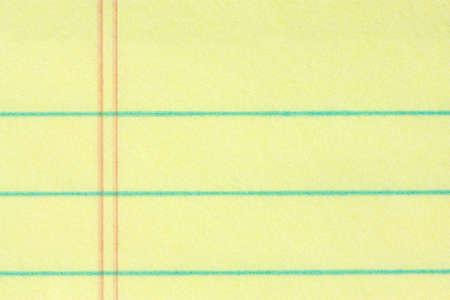 foglio a righe: Close-up del diritto di blocco della carta sfondo giallo - aggiungere la vostra attivit� messaggio Archivio Fotografico