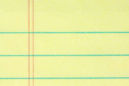 Close-up of legal pad of yellow paper background - add your business message