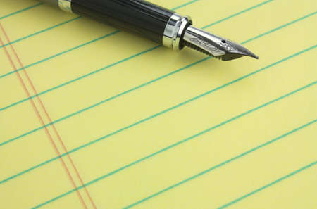 message pad: Fountain pen on yellow legal pad of paper - add your business message Stock Photo