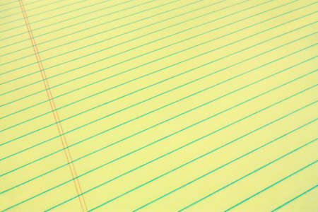 ruled: Legal pad of yellow paper for your business message, wide angle view