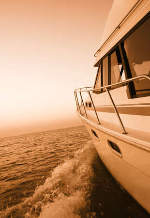 duotone: Duotone image of a boat on a lake at sunset