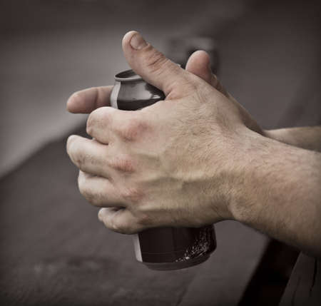 Working man's rough hands hold a can of beer Stock Photo - 5433478