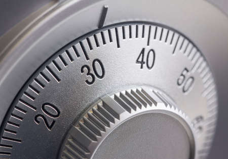 lock up: Close-up of a combination dial on a safe. Stock Photo