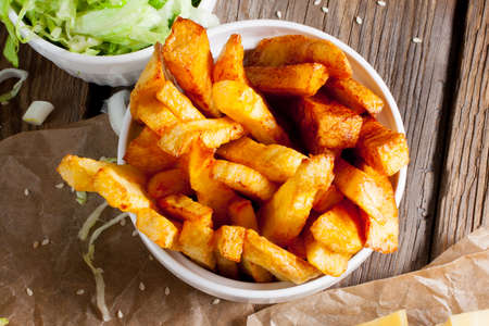 french fries: French fries in white bowl. Stock Photo