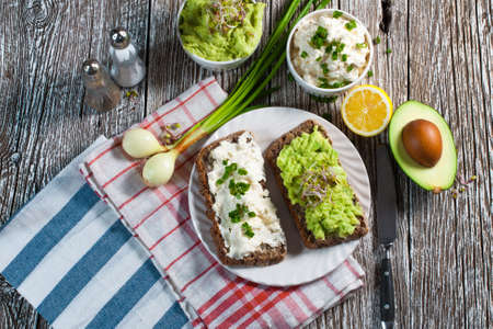 eating pastry: Healthy breakfast with guacamole and cottage cheese. Stock Photo