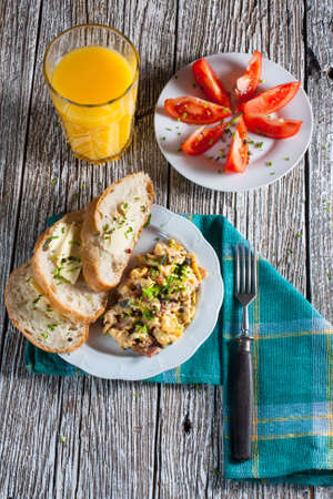 scrambled eggs: Scrambled eggs with ham and chives.