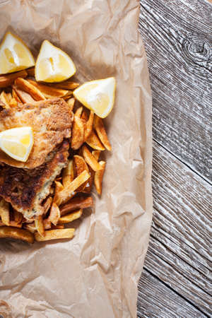 british cuisine: Fish and Chips on paper.