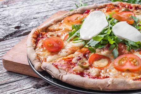 neapolitan: Vegetarian pizza with mozzarella arugula and cherry tomatoes.