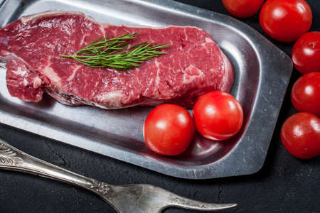 steak beef: Raw steak with tomatoes, mushrooms and dill.