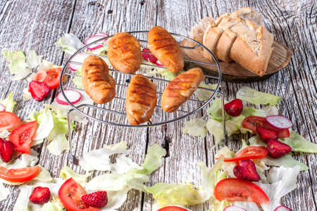 oscypek: Grilled sheep cheese with a salad of tomato and strawberry.