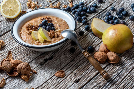 peanut butter: Home porridge with honey, nuts and berries. Stock Photo