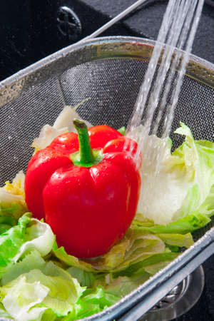 rinse: Rinse fresh vegetables in the sink with water